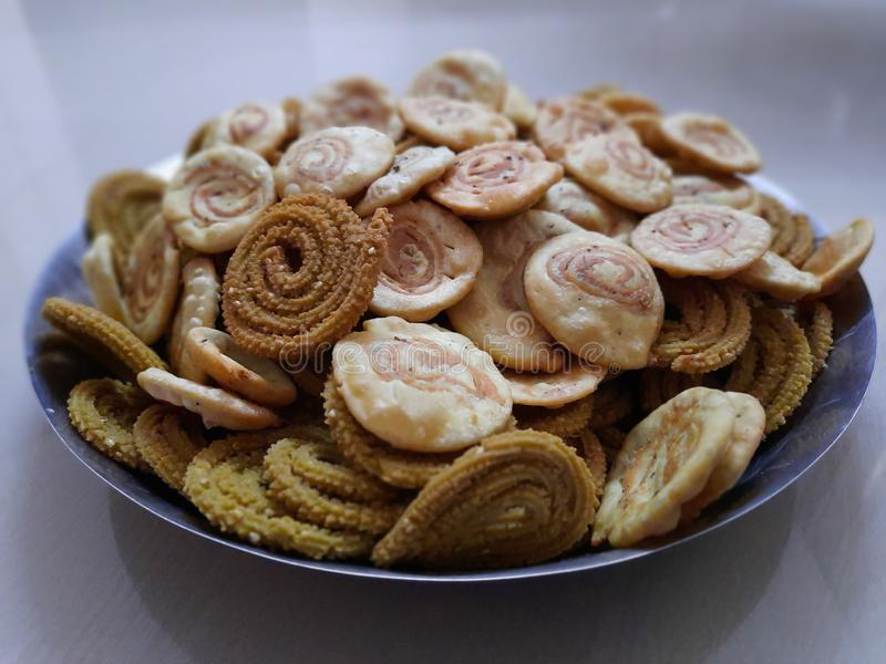 These are the indian snacks and Namkeens known as chakli and mathri made especially in diwali festival. stock images