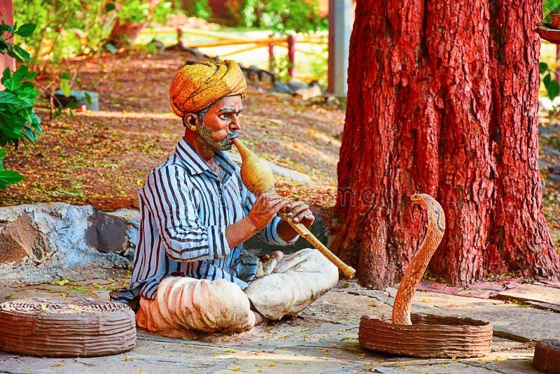 Indian snake charmer. Gram Sanskruti Udyan, Pashan, Pune, Maharashtra. Mock village royalty free stock photo