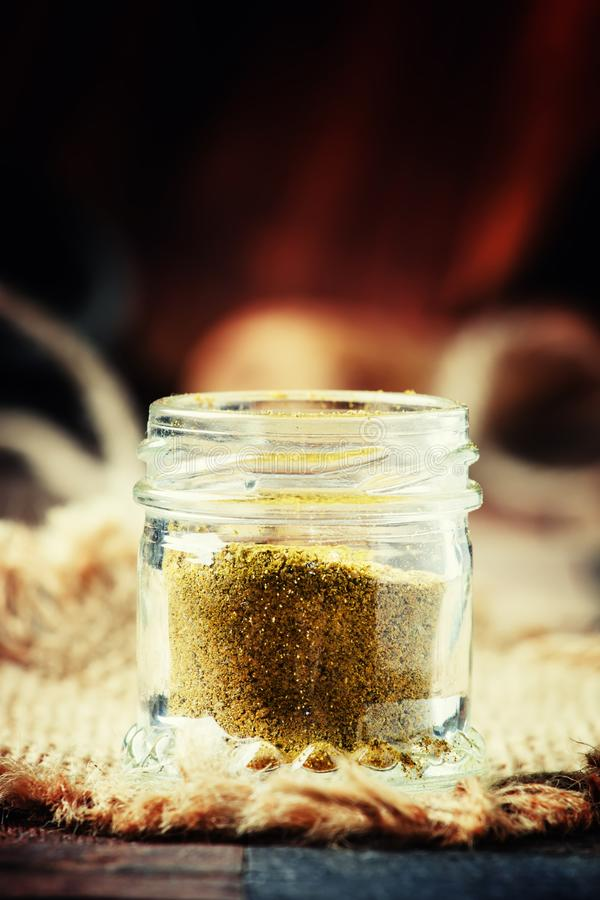 Indian spice garam masala in a glass jar, selective focus royalty free stock images