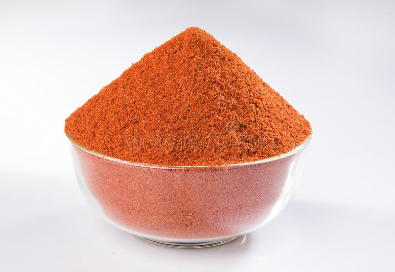 CHILLI SPICES POWDER GRIND FLAVOUR. INDIAN SPICES CHILLI POWDER GRIND BOWL WOODEN YELLOW FLAVOUR MIRCH royalty free stock photos