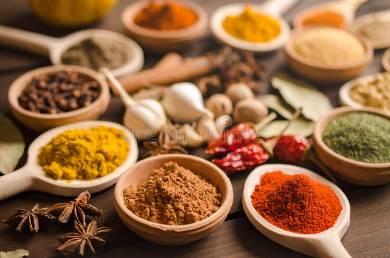 Indian spices and dried herbs on wooden table. Selective focus stock photo