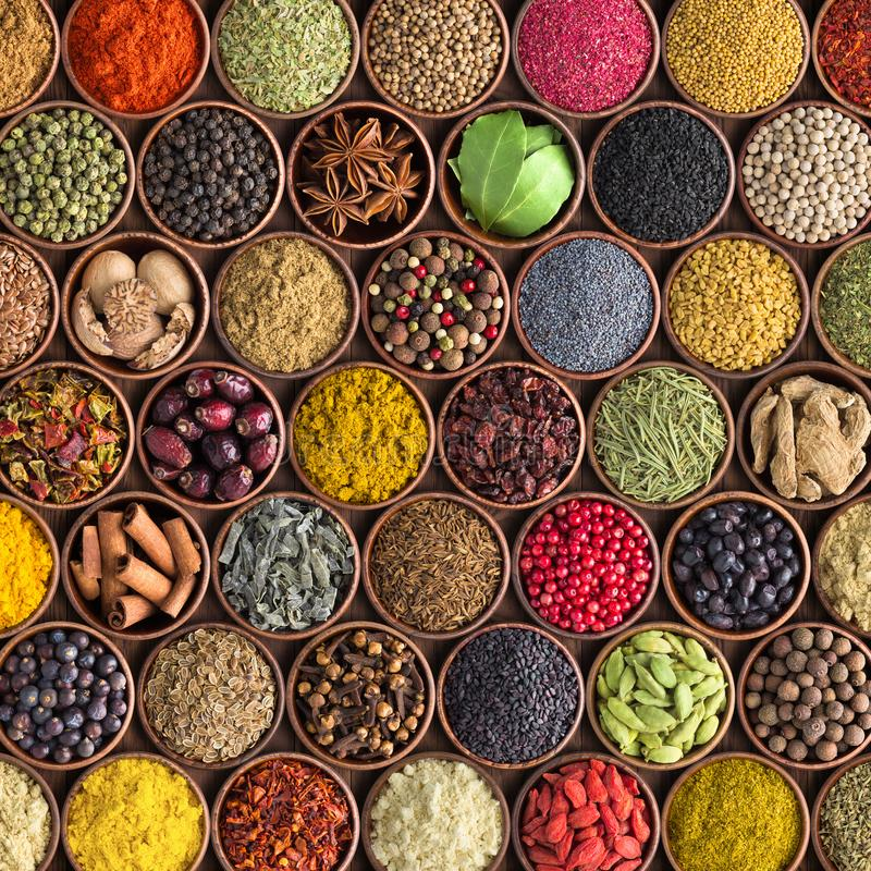 Colorful spices and herbs background. large set of seasonings in stock images