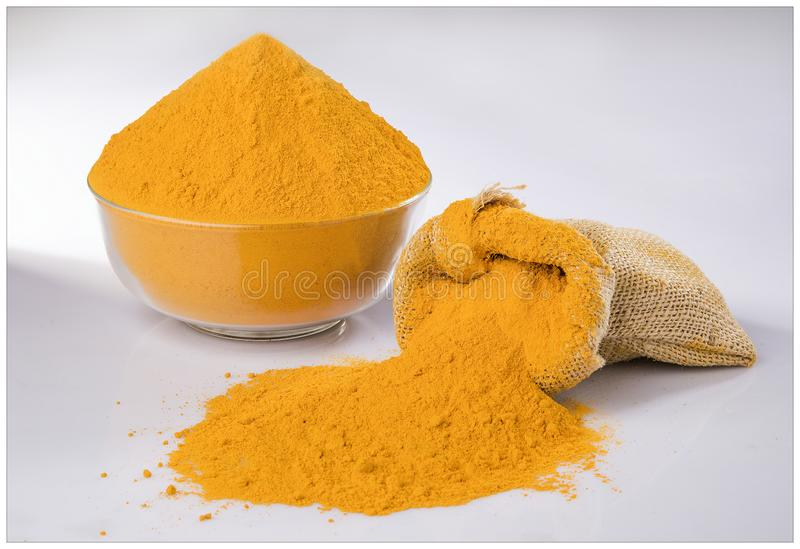 CHILLI TURMERIC POWDER GRIND FLAVOUR. INDIAN SPICES TURMERIC POWDER GRIND BOWL WOODEN YELLOW FLAVOUR MIRCH royalty free stock photos