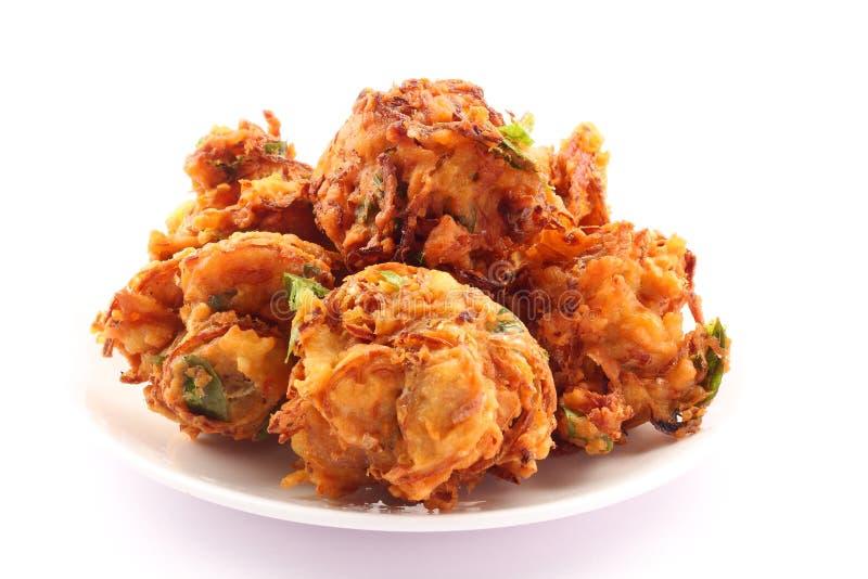 Indian spicy onion pkkoda. Or pakoras royalty free stock photo