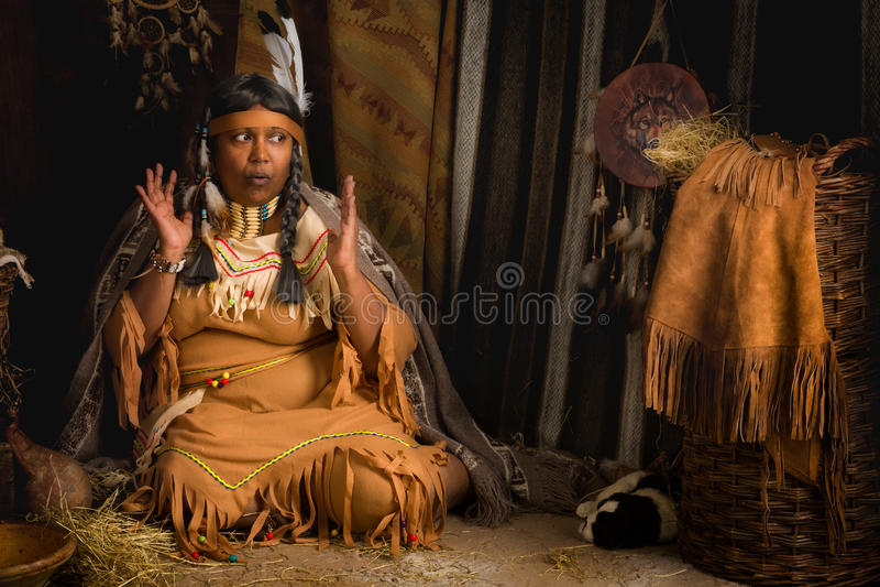 Indian storyteller. Weathered mature tribal female storyteller talking about heroic times royalty free stock image
