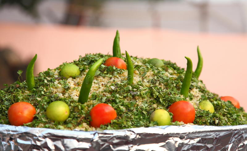 Indian street Food: Cooked rice with raw vegetables royalty free stock photo