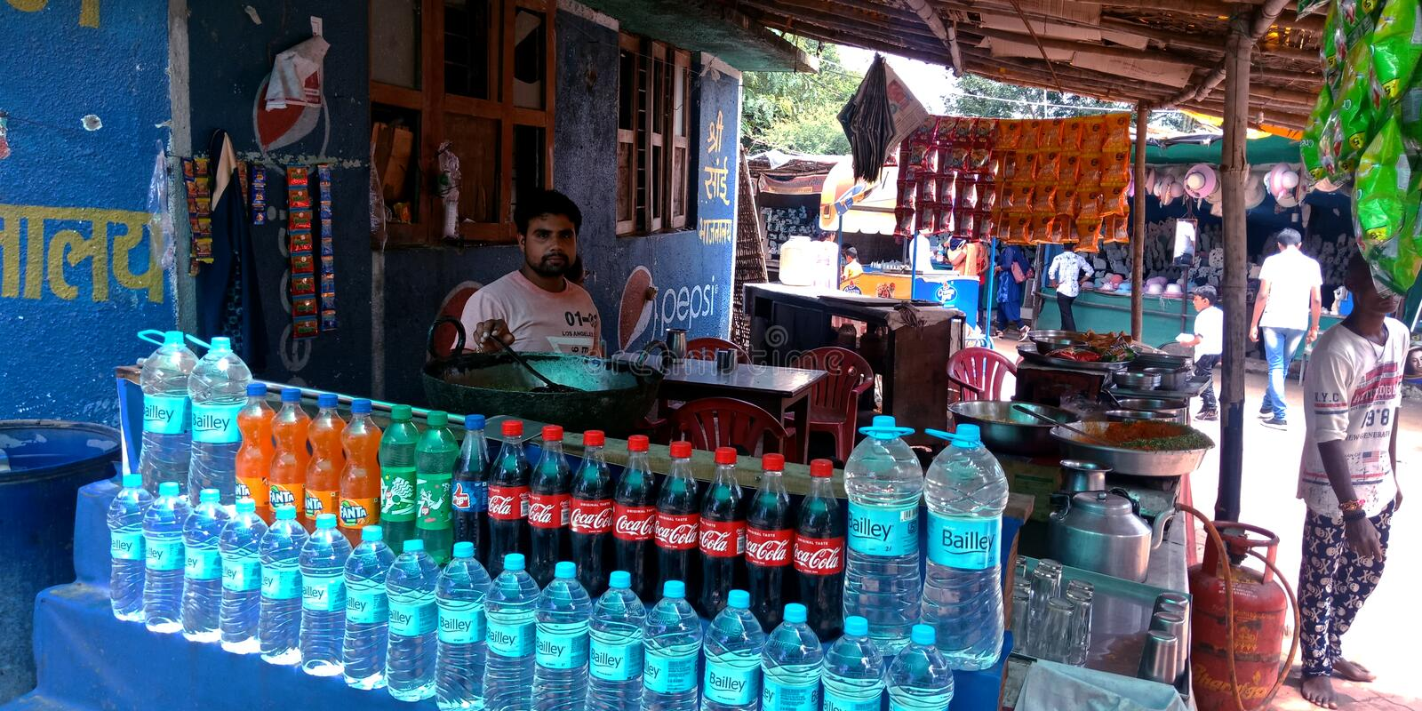 Indian street food corner selling cold drinks and water bottle at tourist place in India stock photo