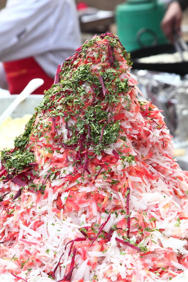 Indian street Food: Sliced raw radish, carrot with coriander leaves royalty free stock images