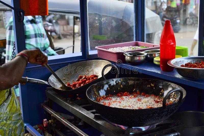 Indian street food stall with pans of fried pakora stock photography