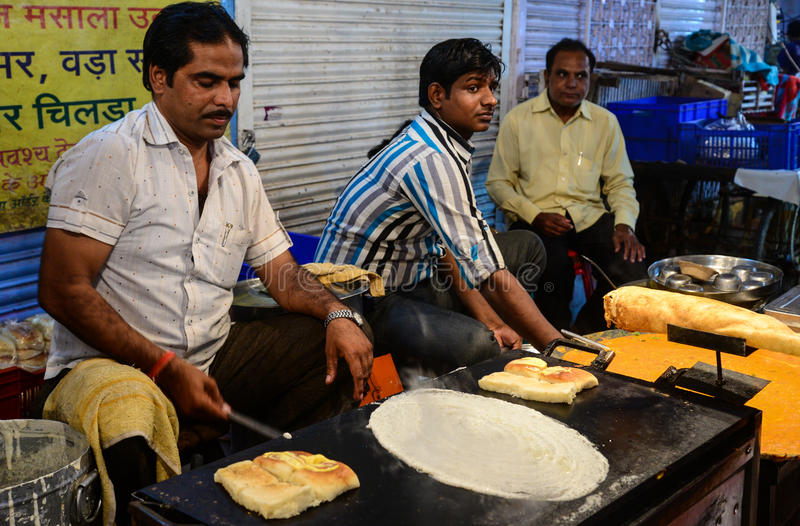 Indian street food vendors. Cooking indian street food royalty free stock image