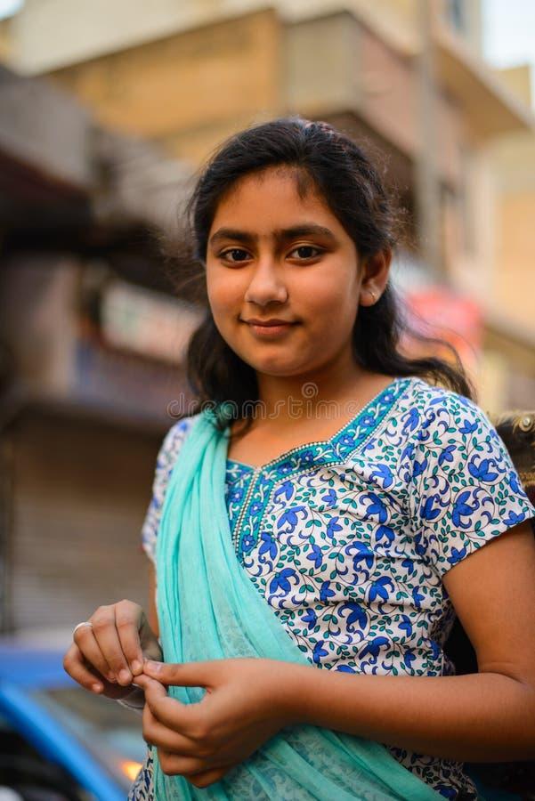 Indian street girl smiling. April 10, 2016 in Paharganj Delhi, India royalty free stock photos