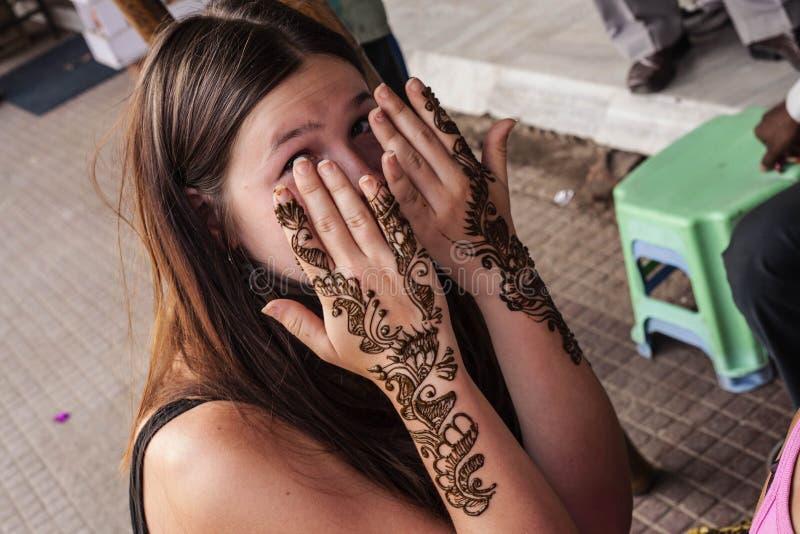 Mehndi Uses For Hair : Indian street master uses henna paste or mehndi editorial
