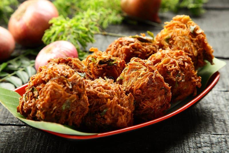 Indian strret food onion pakora fritters. Indian street snack onion pakoda or fritters stock image