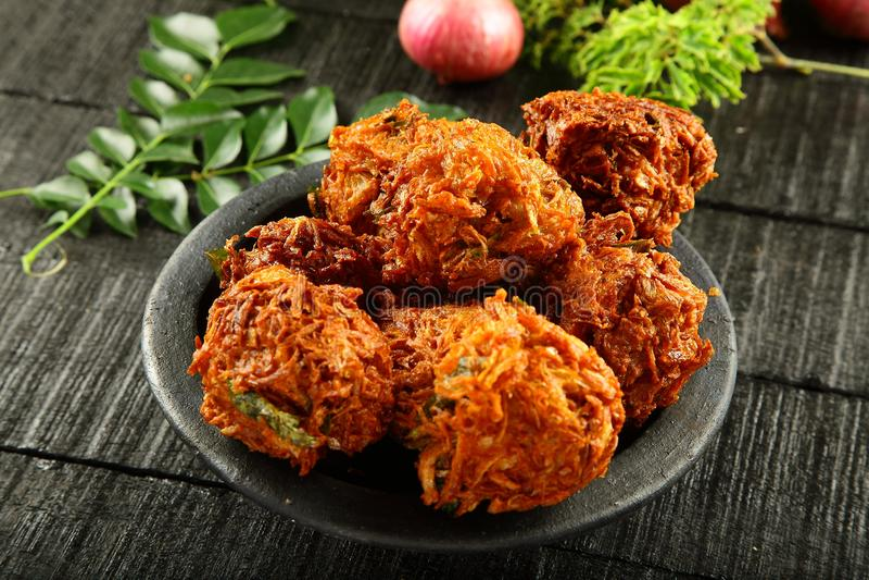 Indian spicy onion pkkora. Indian street snack onion pakoda stock photos
