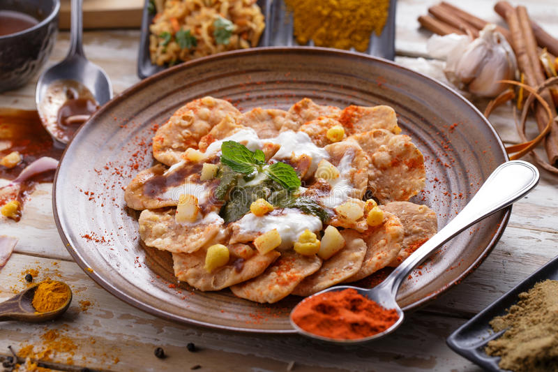 Indian streetfood papri chaat garnished and served with yoghurt royalty free stock images
