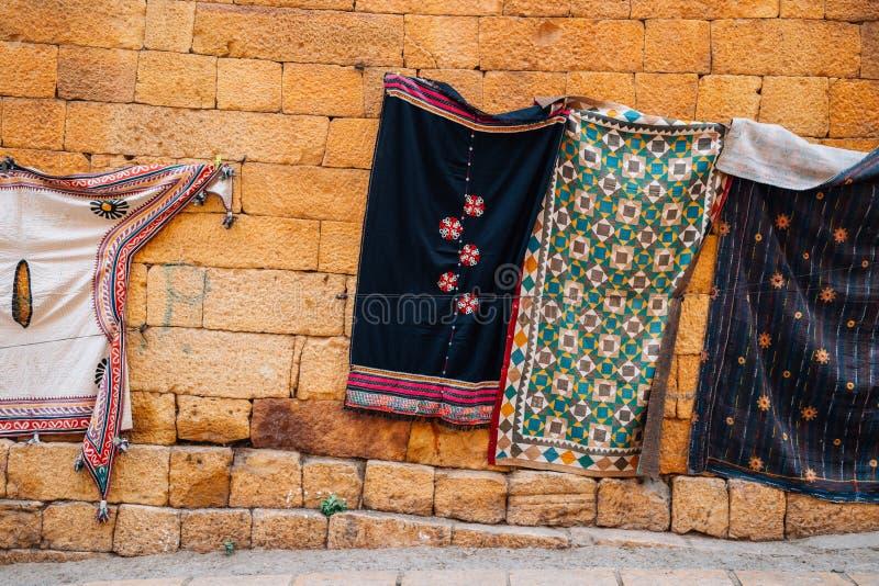 Indian style oriental carpets at old street market at Jaisalmer, India stock photo