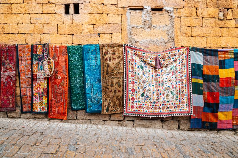 Indian style oriental carpets at street market in Jaisalmer, India royalty free stock image