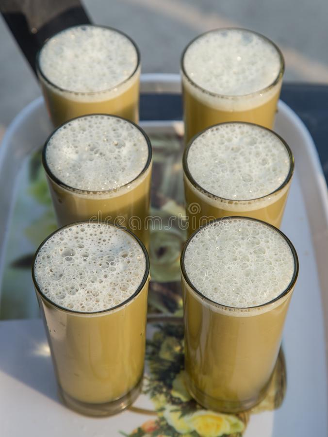 Indian sugarcane juice in glass royalty free stock photos
