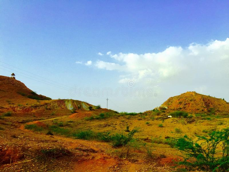 Mountain and Neela weather greentree. Rajasthan banetha picture mountain and temple background greentree weather Neela pincod no royalty free stock image