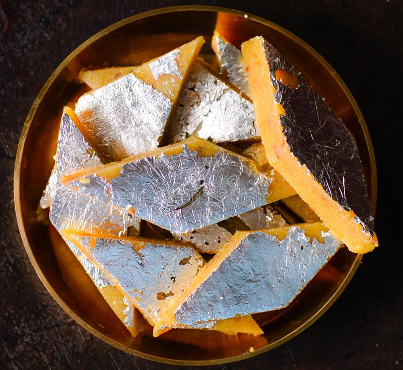 Indian Sweet - Badam katli. Badam katli: Indian Sweet prepared out of Milk product, sugar and almonds optionally decorated with saffron strands and edible silver stock photo