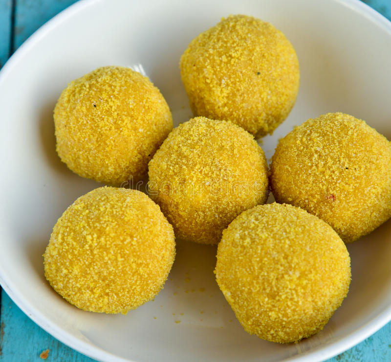 Indian Sweet - Besan laddo. Besan laddo: Indian Sweet prepared out of Milk product, sugar and aromatic ingredients stock image