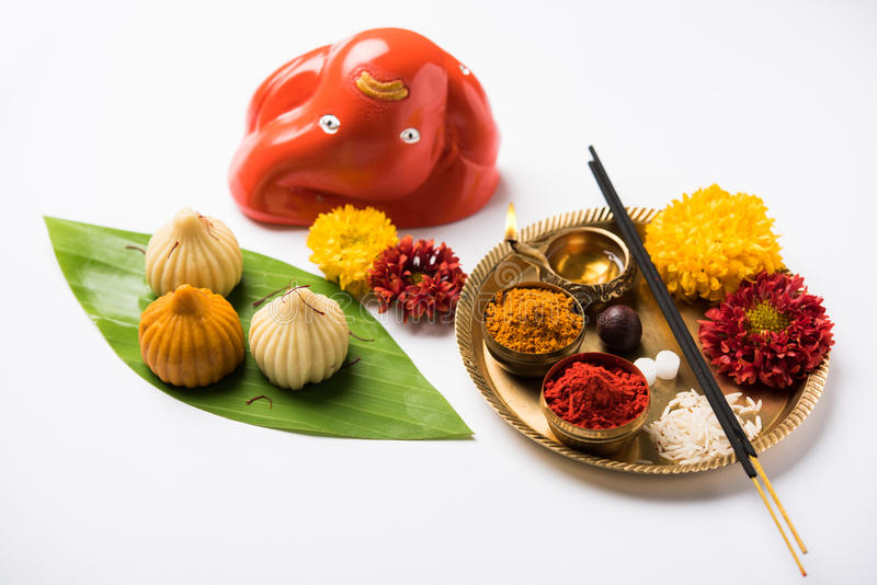 Indian sweet food called modak prepared specifically in ganesh festival or ganesh chaturthi. Indian Festival - Indian sweet food called Modak offered as prasad royalty free stock photo