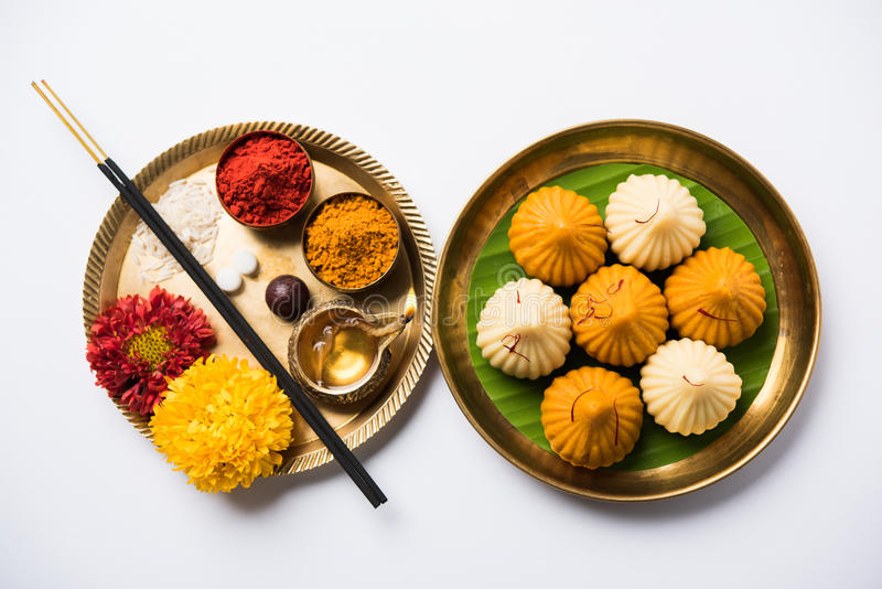 Indian sweet food called modak prepared specifically in ganesh festival or ganesh chaturthi. Indian Festival - Indian sweet food called Modak offered as prasad stock photos