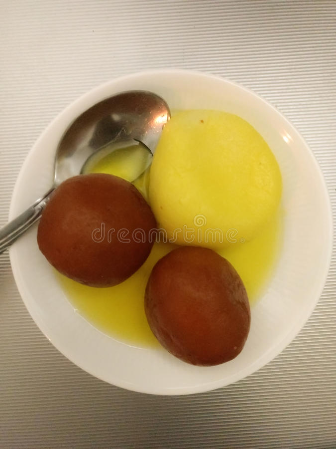 Indian Sweet Gulab Jamun and Rasgulla stock images