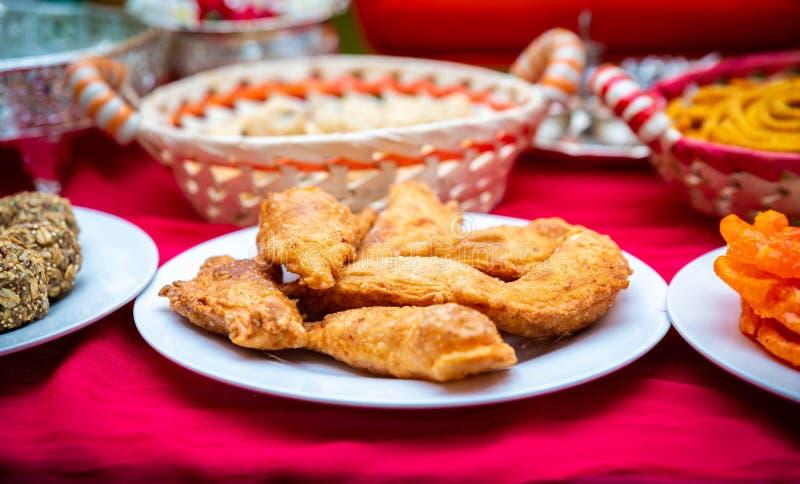 Indian sweet kajjikaya, indian food, indian snacks stock photo