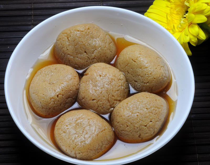 Indian Sweet - Rasagulla. Rasagulla - is a very popular cheese based, syrupy sweet dish originally from the India royalty free stock photos