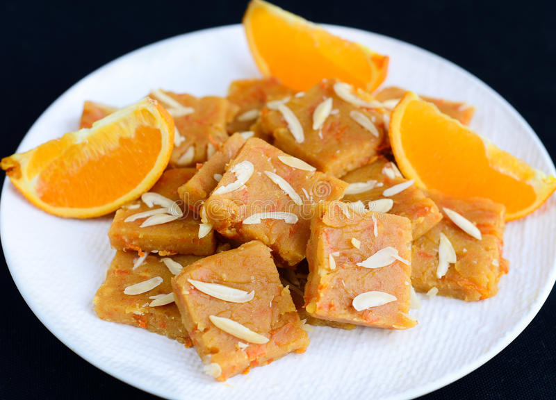 Indian Sweets - orange burfi. These are sweets from India prepared out of Milk product, sugar and aromatic ingredients,orange during Hindu festival Diwali royalty free stock photo