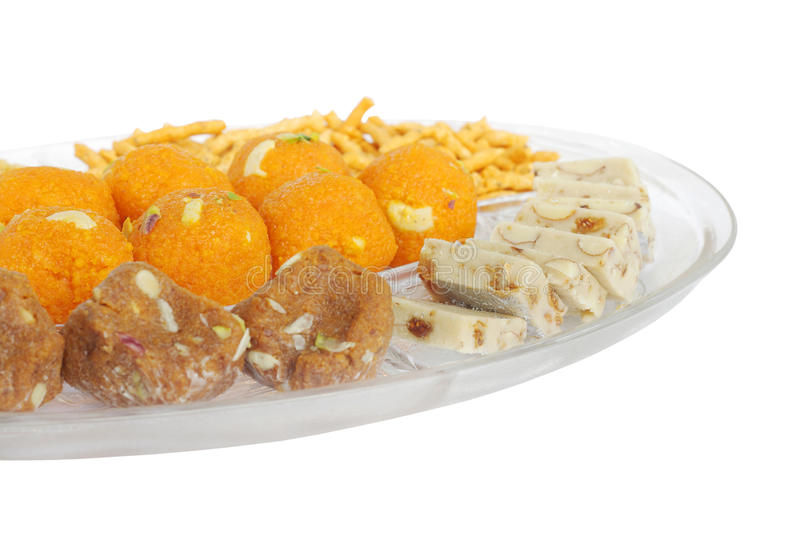 Indian sweets at shallow DOF in the mid of plate royalty free stock photos