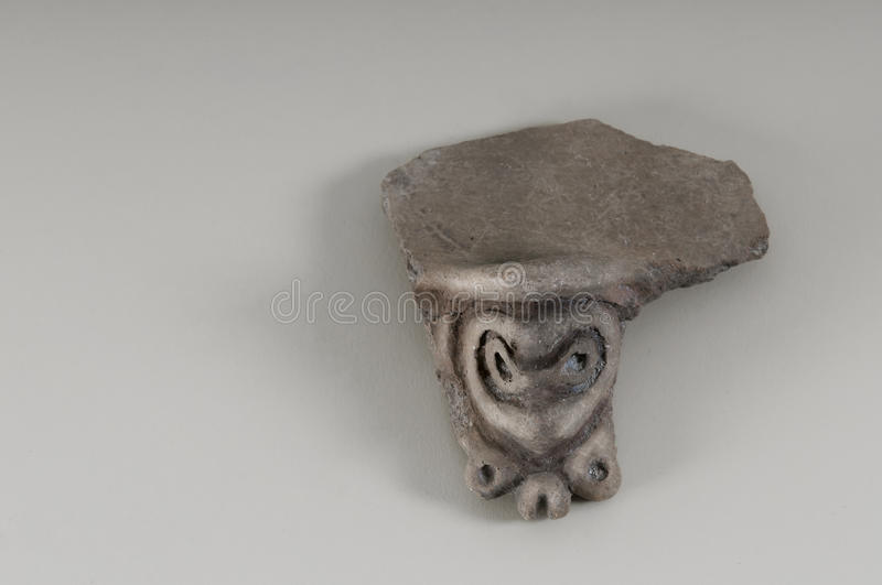 Indian Taino pot handle faces design very old stock photo