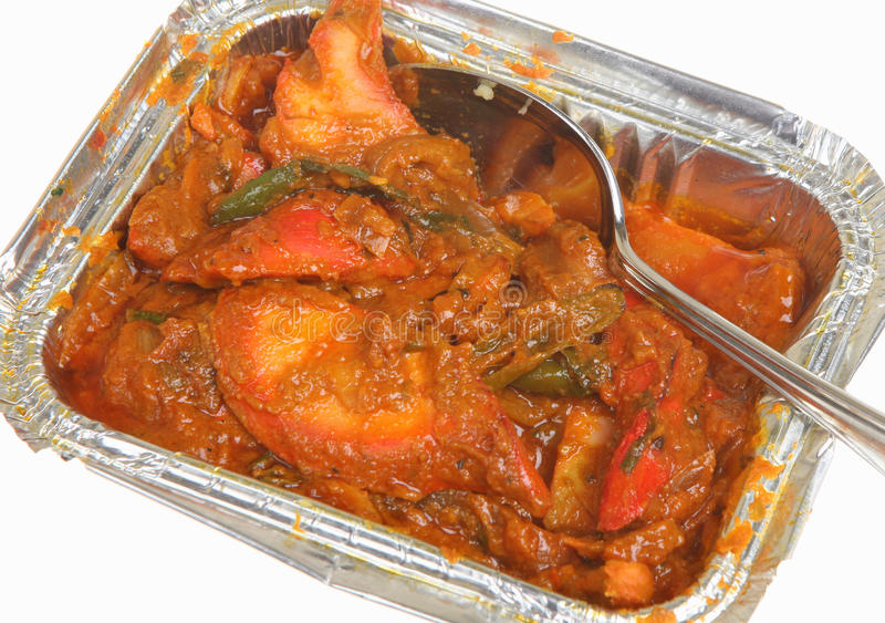 Indian Takeaway Curry. Indian chicken jalfrezi curry in takeaway container royalty free stock photography