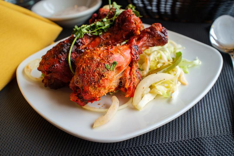Indian Tandoori Chicken. Indian cuisine spicy Tandoori chicken with cilantro garnish stock photography