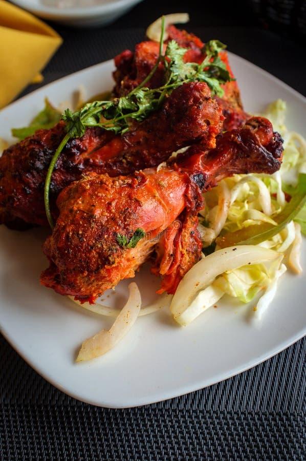 Indian Tandoori Chicken. Indian cuisine spicy Tandoori chicken with cilantro garnish stock image