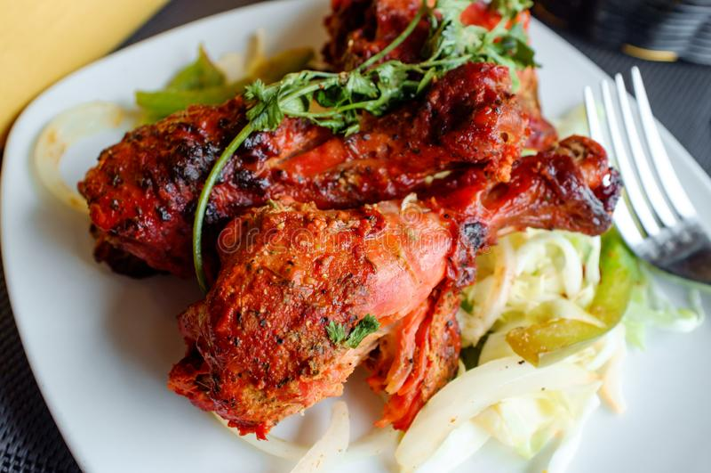 Indian Tandoori Chicken. Indian cuisine spicy Tandoori chicken with cilantro garnish stock photos