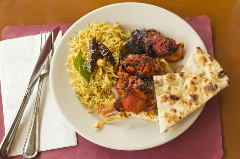 Indian Tandoori Chicken. With fresh naan and tamarind rice royalty free stock images