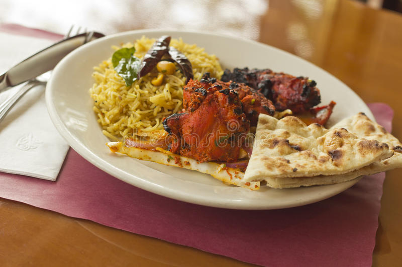 Indian Tandoori Chicken. With fresh naan and tamarind rice royalty free stock photos