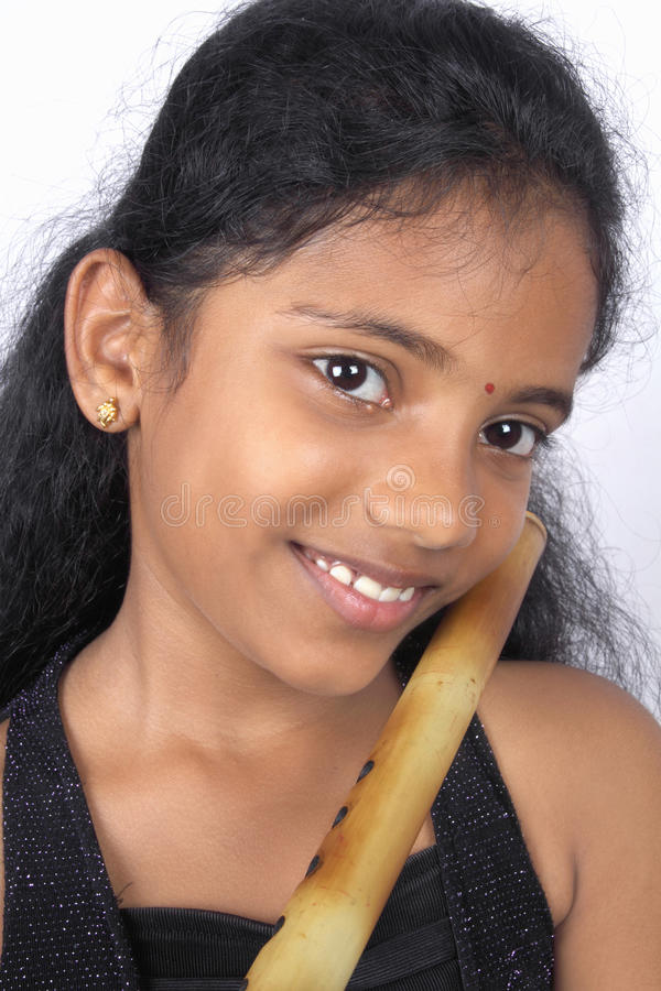 Indian Teenage Girl With Flute royalty free stock photos