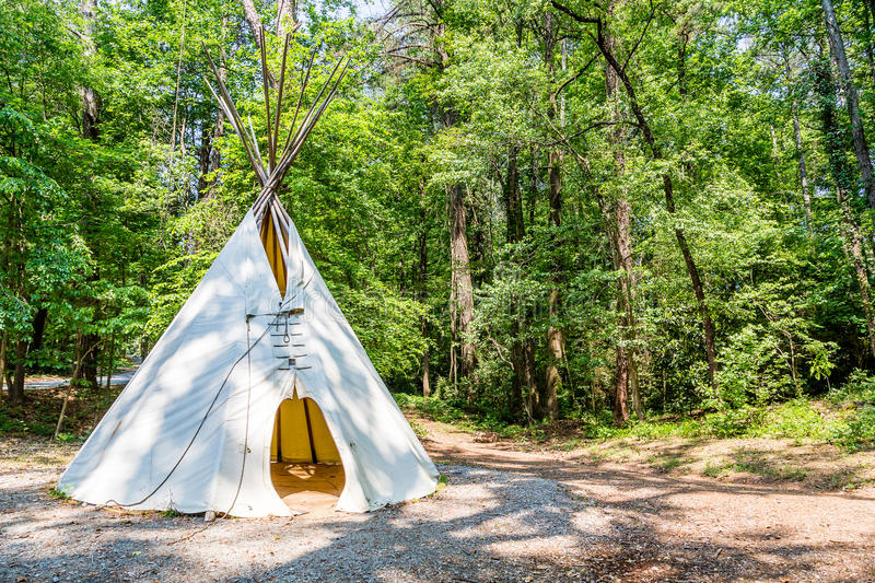 Indian Teepee in Woods. A Native American teepee in a wooded clearing stock photos