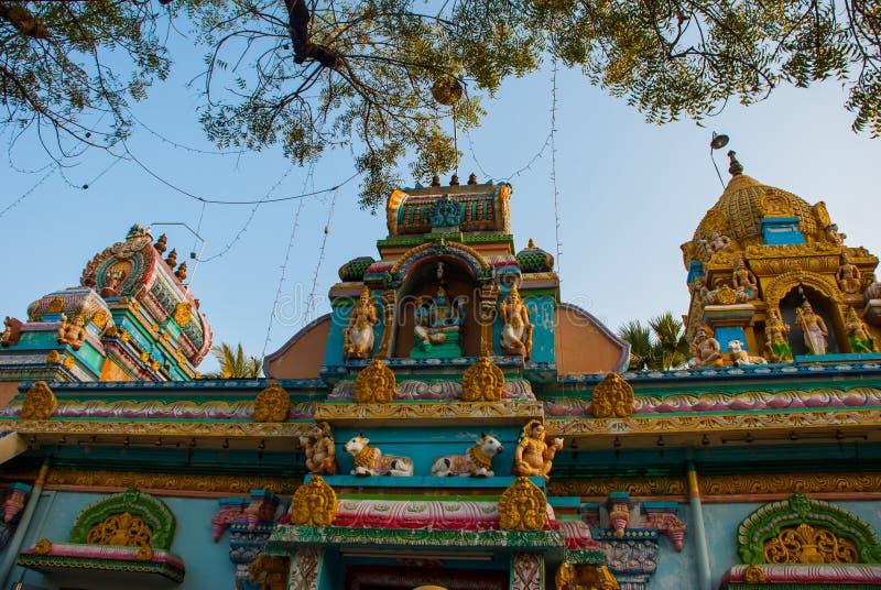 Indian temple on the street. Mawlamyine. Myanmar. Burma. Beautiful Indian temple on the street. Mawlamyine. Myanmar. Burma. Street with houses stock image