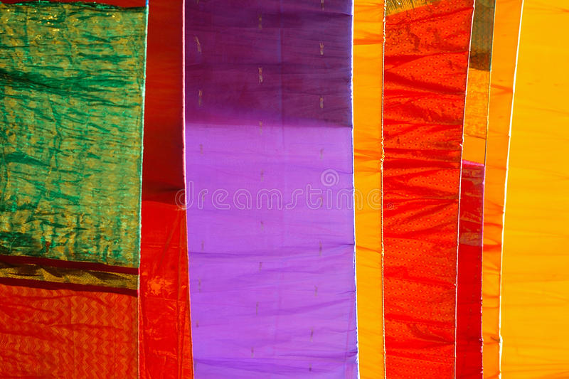 Indian Textiles. Indian Textiles at outdoor drying at ray of sunlight royalty free stock photo