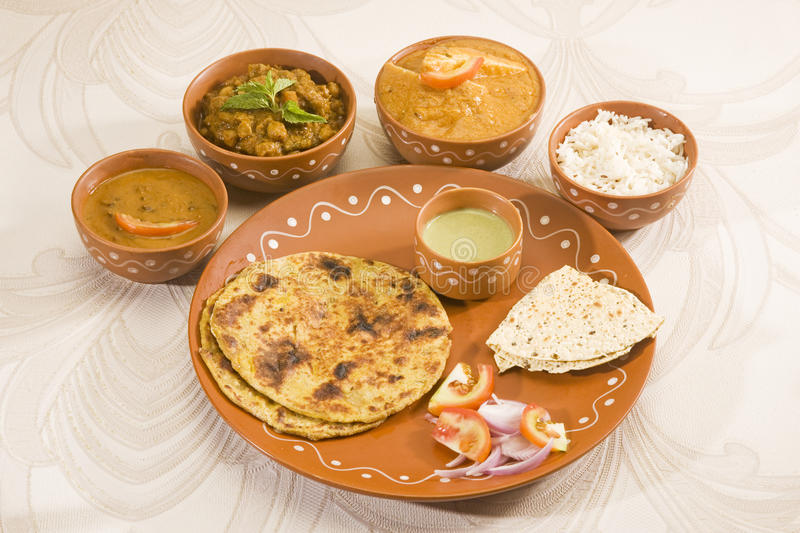 Indian Thali with Paratha royalty free stock images