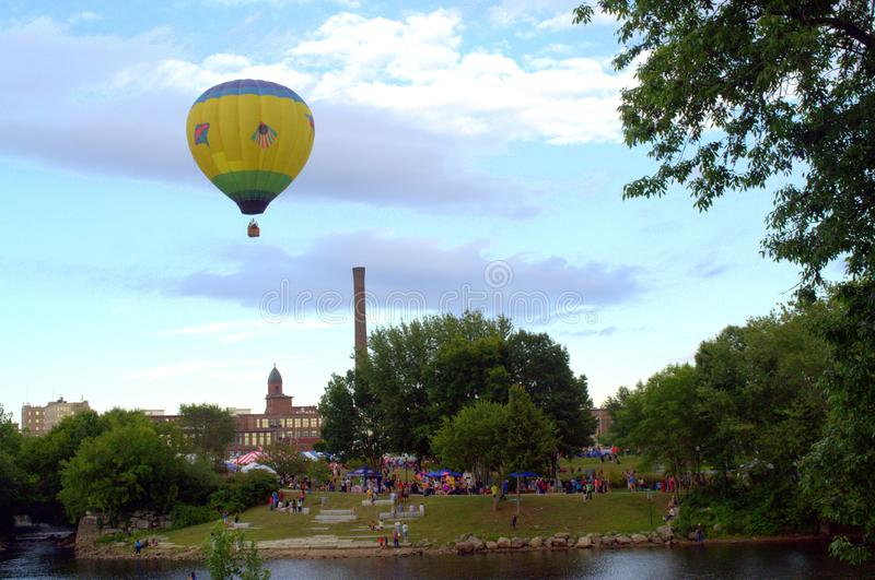 Indian Themed Hot Air Balloon takes flight. Lewiston Auburn Maine`s annual Great Falls Balloon Festival. A vibrant American Indian themed colorful balloon takes royalty free stock image