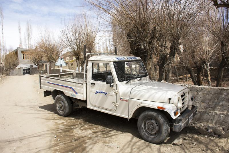 Stop pickup car truck on small road in alley in Ladakh village at Himalayan valley  in Jammu and Kashmir, India stock photography