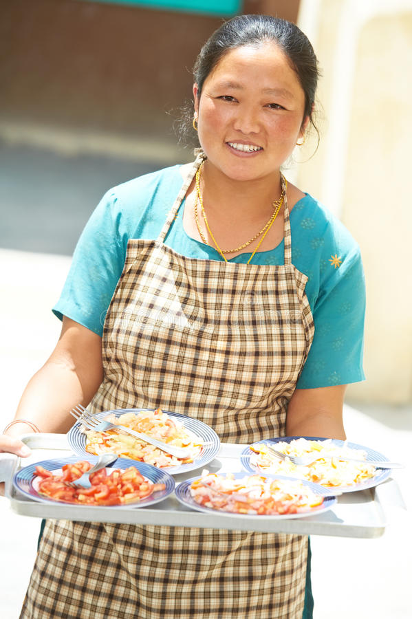 Indian tibetan Woman waitress with tray stock images