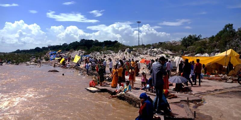 Indian tourist gathering around waterfalls at Narmada river in India stock images