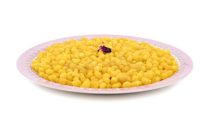 Indian Traditional Sweet Food Laddu Bundi on White Background. Indian Traditional Sweet Boondi or Bundi is a Popular Delicious Dish Made of Chickpea Flour stock photos