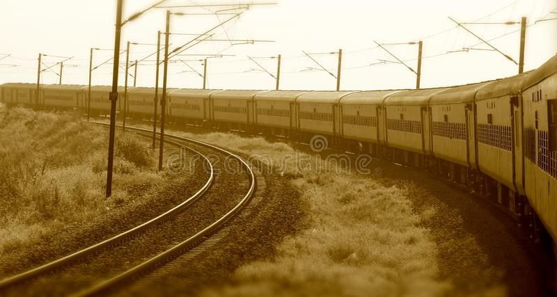 Indian train running on the railways stock photograph. A large electric Indian train is running on the railways stock photograph stock images